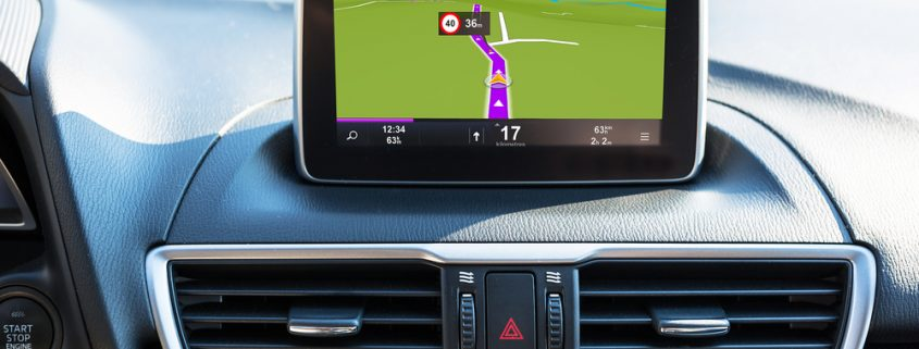 Satellite Navigation System in the centre of the dashboard of a car.