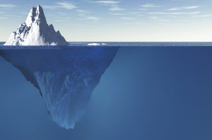 View of Iceberg showing 10% above the water ad 90% blow the surface of the ocean